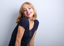 Laughing beautiful blond woman with short hairstyle posing Royalty Free Stock Photography