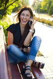Laughing beautiful brunette with phone in hand Stock Photos