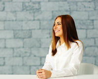 Laughing beautiful businesswoman sitting at the table Stock Images