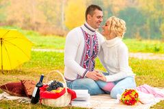 Laughing beautiful couple at the picnic Royalty Free Stock Images