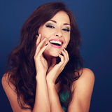 Laughing beautiful curly hair style woman touching manicured fin Stock Photos