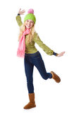 A laughing beautiful girl in funny cap is jumping Stock Photos