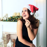 Laughing beautiful girl in hat of Santa Claus Royalty Free Stock Photo