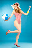 Laughing beautiful girl pin-up in a pink bikini with beach ball Royalty Free Stock Photos