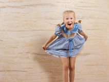 Laughing beautiful little girl taking a courtesy Royalty Free Stock Photos