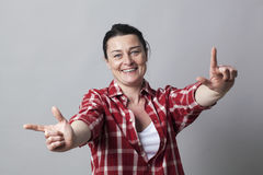 Laughing beautiful middle aged woman gesturing hands in foreground Royalty Free Stock Image