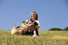Laughing beautiful woman playing with her dog royalty free stock photo