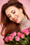 Laughing beautiful woman with roses Stock Image