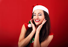 Laughing beautiful woman with toothy smile in santa claus christ Stock Image