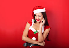 Laughing beautiful woman with toothy smile in santa claus christ Royalty Free Stock Photo