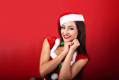 Laughing beautiful woman with toothy wide smile in santa claus c Stock Photo