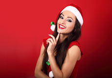 Laughing beautiful woman with toothy wide smile in santa claus c Stock Photography
