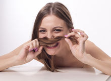 Laughing beautiful young woman Stock Images