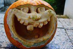 Laughing big mouth halloween jack-o-lantern made of carved pumpkin Stock Photos