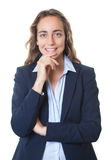 Laughing blond businesswoman with blue eyes and blazer Stock Photos
