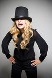 Laughing blond girl with top hat Stock Photo
