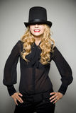 Laughing blond girl with top hat Stock Photos