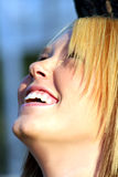 Laughing Blond Looking Up Stock Photo