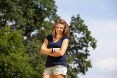 Laughing blond teenage girl Stock Image