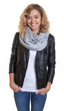 Laughing blond woman in a leather jacket Stock Photography