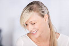 Laughing blond woman Royalty Free Stock Photography
