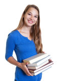 Laughing blond woman loves books Stock Images