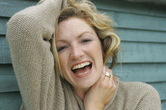 Laughing Blonde. A young blond woman outside laughing Stock Photography