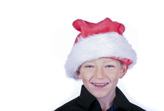 Laughing blonde boy in a santa hat Stock Photography