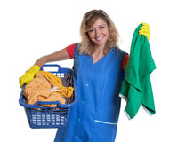 Laughing blonde housewife with dirty clothes. On an isolated white background for cut out royalty free stock photography