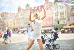Laughing blonde making soap bubbles Royalty Free Stock Photos