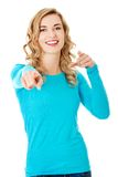 Laughing blonde woman pointing on you Royalty Free Stock Photography