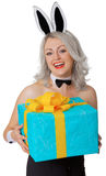 Laughing blonde woman with rabbit ears and a gift Stock Images