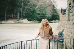 Laughing Blonde Woman Standing Near Waterfall Royalty Free Stock Photography