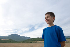 Laughing boy. A laughing boy at the mountains Royalty Free Stock Image