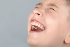 Laughing boy. Face close-up Royalty Free Stock Photo