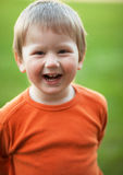Laughing boy. Laughing little boy photographed outdoors; blurred background Stock Photography