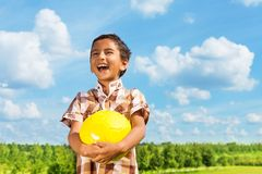 Laughing boy with ball stock photo