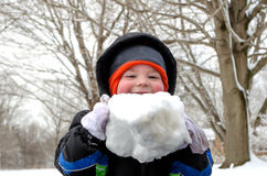 Laughing boy with big snow ball stock photo