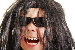 Laughing boy in black wig Royalty Free Stock Image
