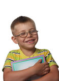 Laughing boy with book Royalty Free Stock Images