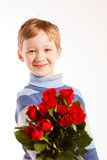 Laughing boy with the bouquet of red roses Royalty Free Stock Photography