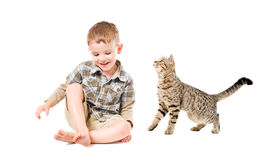 Laughing boy and cat. Beautiful laughing boy and a curious cat Royalty Free Stock Photography