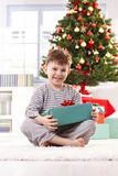 Laughing boy with christmas present Royalty Free Stock Image
