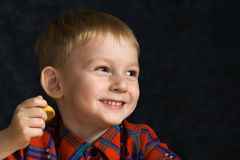 Laughing boy with cookies royalty free stock photography