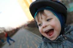 Laughing boy with crash helmet Stock Image