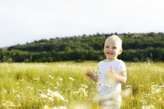 Laughing boy in field Royalty Free Stock Image