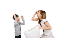 Laughing boy and girl fighting pillow Royalty Free Stock Photos