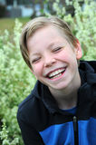 Laughing boy. Laughing happy boy  outside in the garden Stock Image