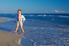 Laughing boy having fun on the beach Royalty Free Stock Images