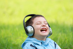 Laughing boy with headphones Royalty Free Stock Photo
